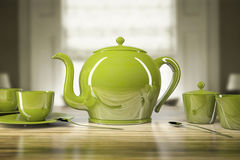 Green teapot and teacups Stock Images