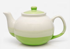 Green teapot  on a white Royalty Free Stock Photos