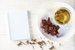 Green teas, chocolates and note pad Stock Photo