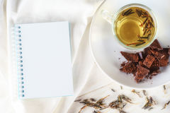 Green teas, chocolates and note pad Royalty Free Stock Photo