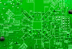 Green technology. Motherboard macro background Royalty Free Stock Photos