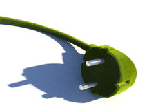 Green Technology. 3D image of a plug covered in grass Stock Photo