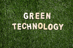 Green Technology Wooden Sign On Grass stock images