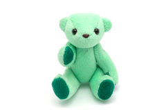 Green teddy bear sitting  on white background Stock Photos