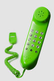 Green telephone. Floating green telephone isolated on white background royalty free stock photography