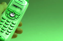 Green Telephone. Man's hand holding green telephone royalty free stock photography
