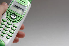 Green Telephone. Man's hand holding green telephone stock photo