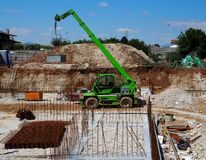 Green telescopic handler crane Stock Images