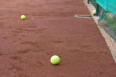 Green tennis balls on the court Royalty Free Stock Image