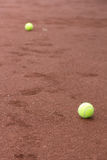 Green tennis balls on the court Royalty Free Stock Photos