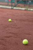 Green tennis balls on the court Royalty Free Stock Photo