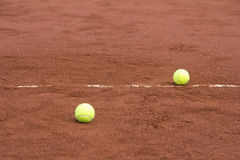 Green tennis balls on the court Royalty Free Stock Images