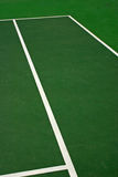 Green Tennis Court. Yellow-red balls on a green tennis court Stock Image