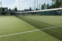 Green tennis court. In the town of la spezia Royalty Free Stock Images
