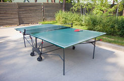 Green tennis table in the park outdoor Royalty Free Stock Image