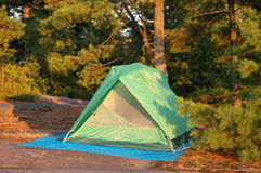 Green Tent. On a rocky campsite stock image