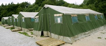 Green tent camp in Pyrenees for  Santiago pilgrims Royalty Free Stock Images
