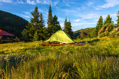 Green tent in a camping base camp in the mountains Royalty Free Stock Photo