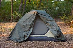 Green tent in the forest Stock Photos
