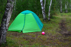 Green tent in the forest Royalty Free Stock Photo