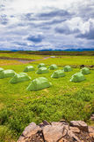 Green tent on grassy lawn Boy Scout camp Stock Photo