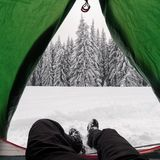 Green tent in winter mountains Royalty Free Stock Photo