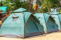 Green tents camping. Green color dome tents camping on nature background royalty free stock images