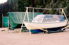 Green tents canvas tents over boats Royalty Free Stock Images
