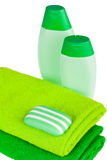 Green terry towels, soap and shampoo Stock Photos
