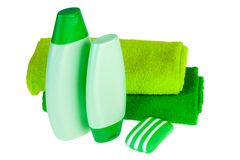 Green terry towels, soap and shampoo Royalty Free Stock Photos
