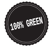 100%-GREEN text, on black sticker stamp. 100%-GREEN text, on black sticker stamp sign Stock Photos