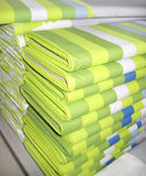 Green textile. Stacks of green striped textile Stock Image