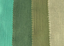 Green textile background. Texture pattern in green colors Stock Photos