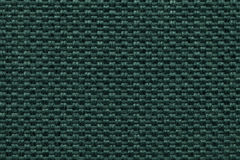 Green textile background with checkered pattern, closeup. Structure of the fabric macro. Royalty Free Stock Images