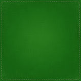 Green textile background with seams Stock Photos