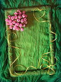Green textile frame with rose heart. Green textile frame with yellow ribbon and rose heart Royalty Free Stock Images