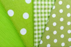 Green textiles as background. Closeup Royalty Free Stock Photography