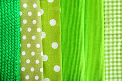Green textiles as background. Closeup Royalty Free Stock Images