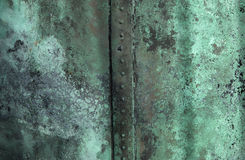 Green texture of rusty copper. Detail of old copper with rusty green surface Stock Images