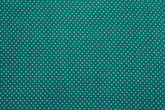 Green texture. White dots on green background Royalty Free Stock Photos
