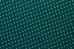 Green texture. White dots on green background Royalty Free Stock Images