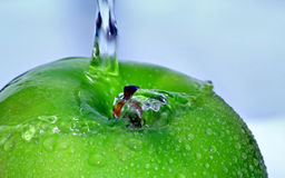 Green Textured Apple. Showing smooth water on one side and drops on the other Stock Photo