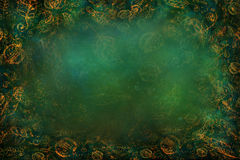 Green textured background with golden leaf pattern and blur effect Royalty Free Stock Image