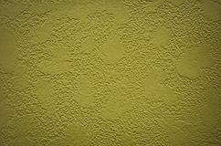 Green Textured Background Wall. Background stucco wall painted drab green with texture Royalty Free Stock Photography