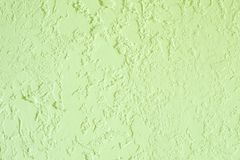 Green textured plastered wall. Fresh otvetka in commercial premises, designer renovation in the house.  royalty free stock photography