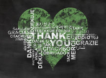 Green Thanks. Thank you, thanks in different languages, word cloud on backboard with green heart stock photos