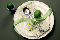 Green theme Happy Easter dinner or breakfast table setting Stock Photos