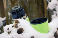 Green thermos with hot tea Royalty Free Stock Photos