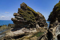Green thickets covered rocky structure at the Kapas Island,Malay Royalty Free Stock Photos