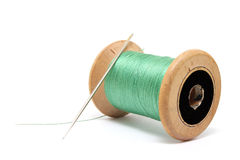 Green thread and needle Royalty Free Stock Image